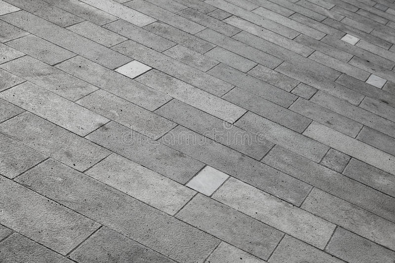 Gray tiled pavement background. Texture royalty free stock photo