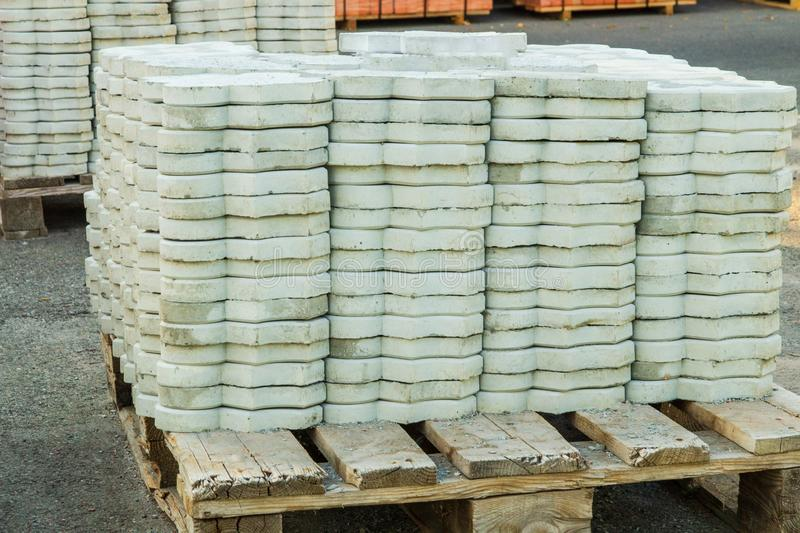 Tiles piled in pallets warehouse paving slabs the factory for its production. Gray tiles piled in pallets warehouse paving slabs the factory for its production royalty free stock photo