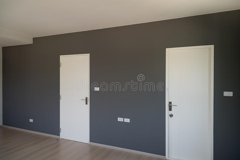 Gray wall decoration with white door closed. Gray wall decoration of the bedroom with white door closed stock images