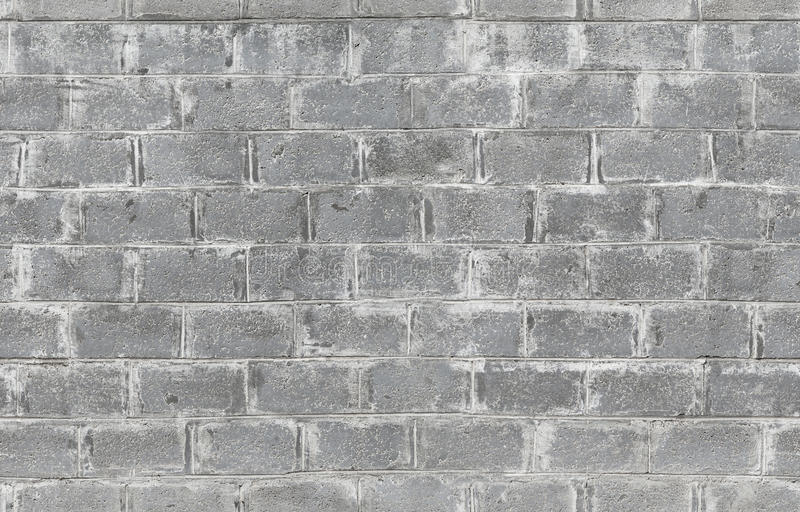Gray wall made of concrete blocks. Seamless texture stock image