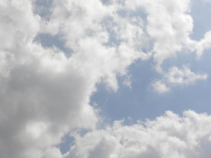Gray and white clouds in blue sky royalty free stock photography