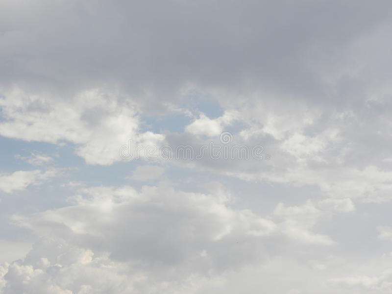 Gray and white cumulus clouds in sky royalty free stock images