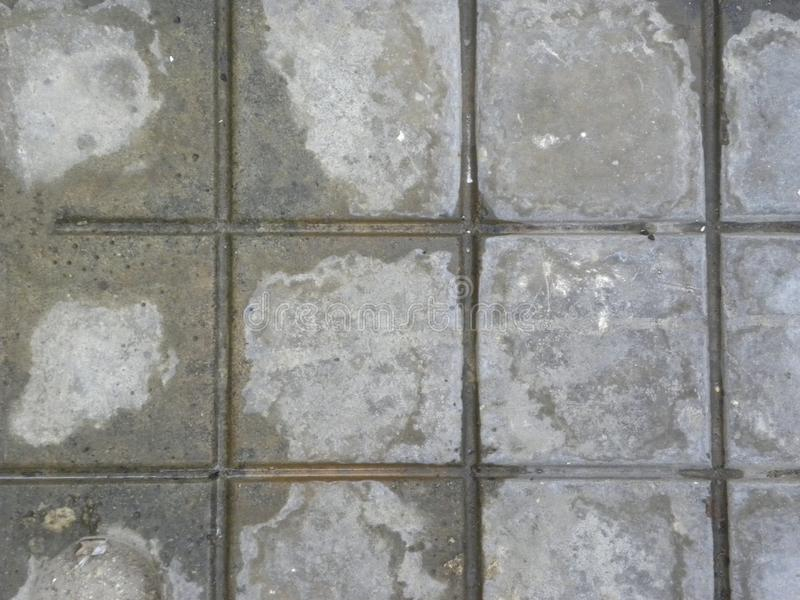 Gray and white color square concrete floor tiles background royalty free stock image