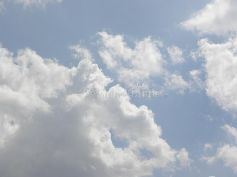 Gray and white Cumulus clouds in blue sky stock images