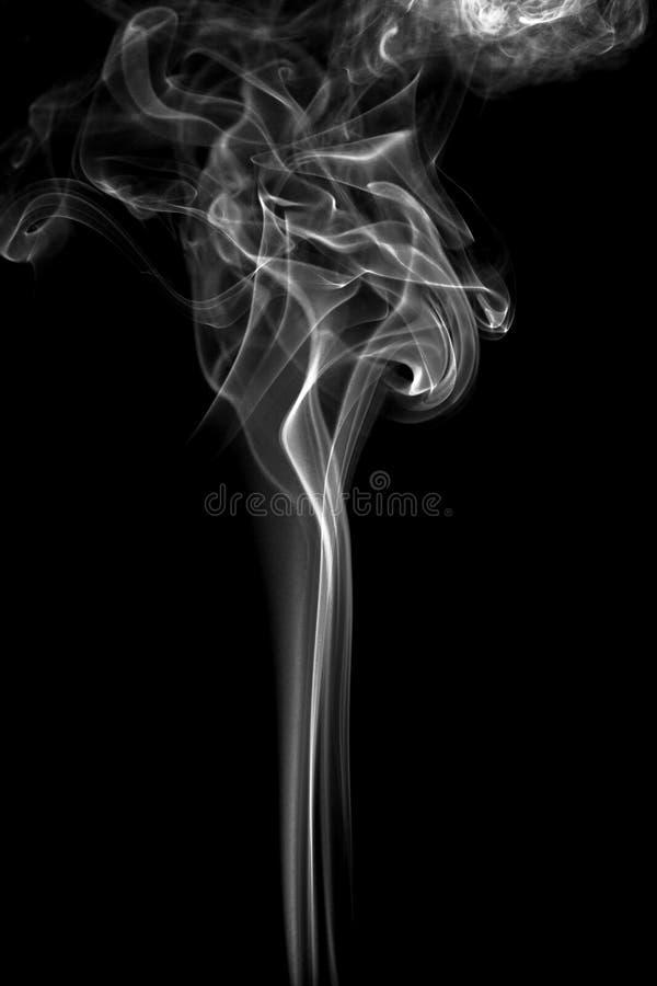 Gray and white smoke. Isolated on black background stock photo