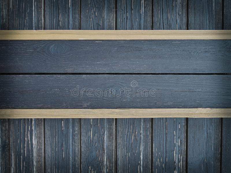 Gray wood plates on old scratched wall stock images
