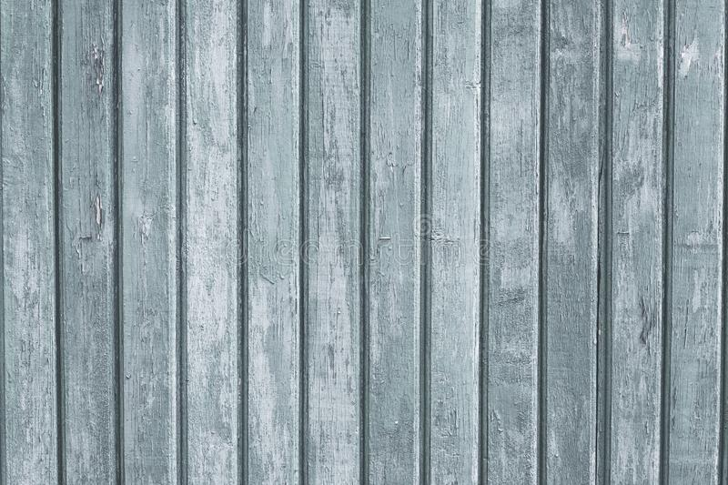 Gray wood vertical planks in rustic style. Grunge background of construction material. Wooden texture board. Pattern of grey old f stock image