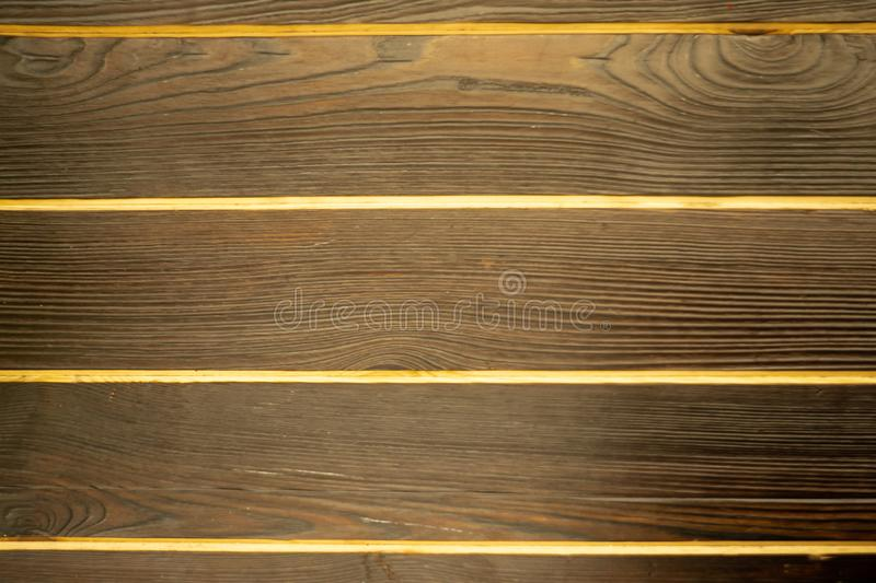 Gray wooden background. Abstract background with nails and joints of boards. Wooden panels of dark wood with light royalty free stock photo
