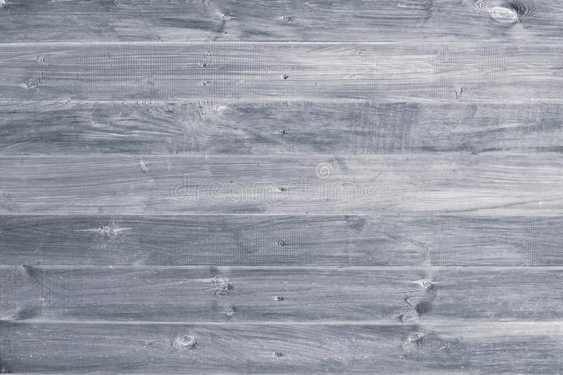 Gray wooden background. Grey wood boards, messy fence, planks. Weathered, vintage surface, pattern. Horizontal stripes on shabby p stock photography