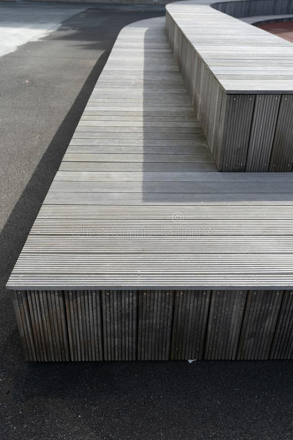 Gray wooden bench in the city yard street royalty free stock image