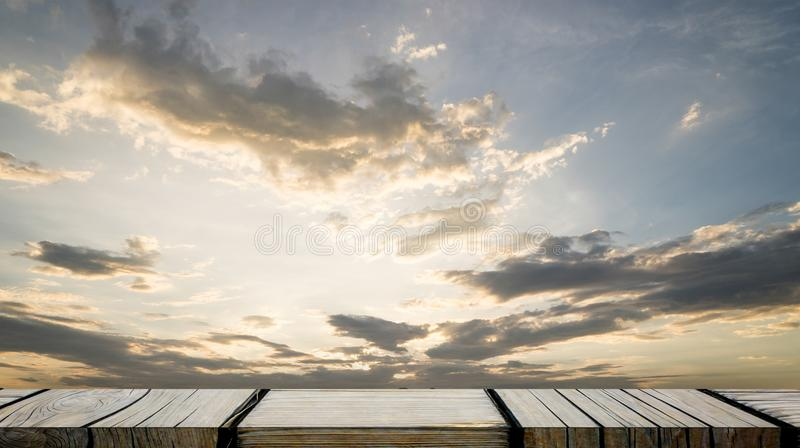 Gray wooden display shelf with golden sky on background stock photography
