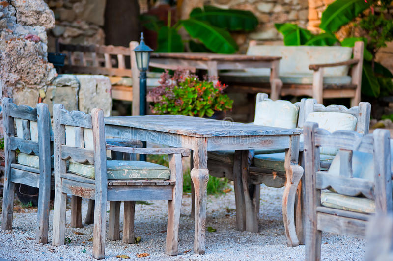 Gray wooden furniture in an outdoor restaurant royalty free stock photo