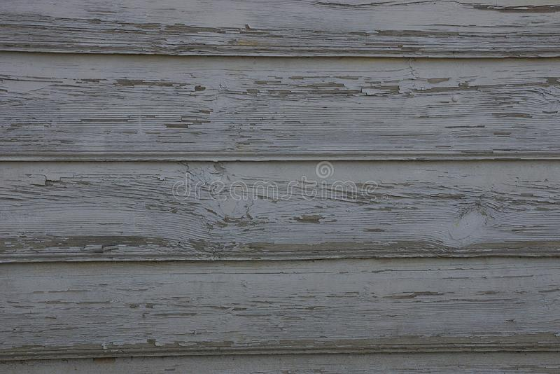Gray wooden texture of wide worn planks in the wall. Of the fence royalty free stock photography