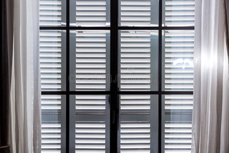 The gray wooden window shutters. stock images