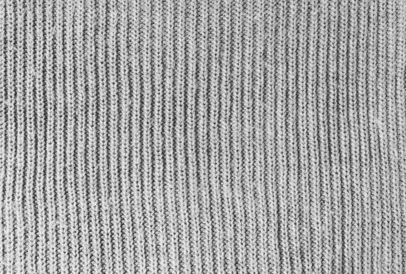 Gray woolen knitwear fabric texture. Closeup of sweater, knitted pattern background. Winter design. Flat lay, top view. royalty free stock photos