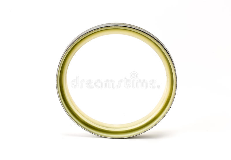 Gray and yellow oil seal isolated on white background stock image