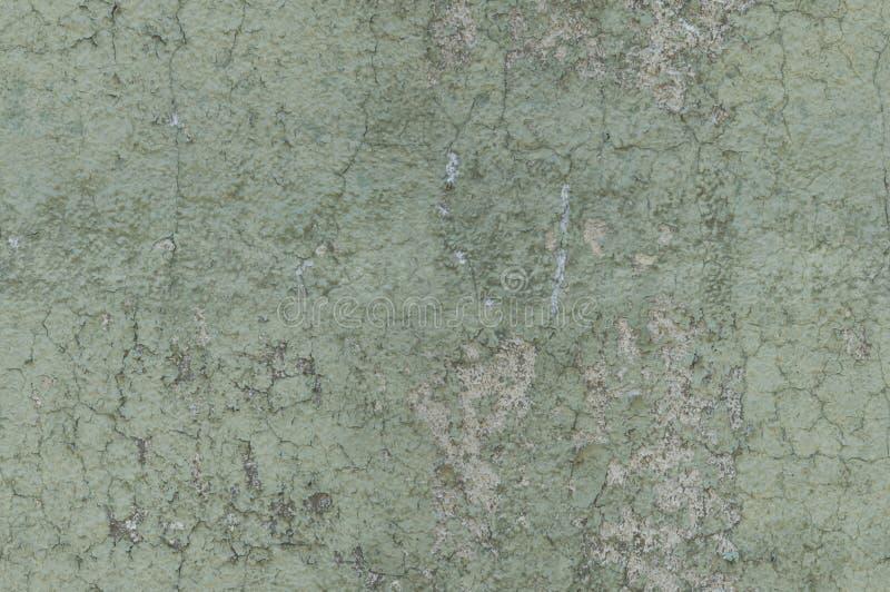Grayish Green Weathered and Distressed Textured Background Wall. Grayish green weathered and distressed textured wall, seamlessly tileable royalty free stock photo