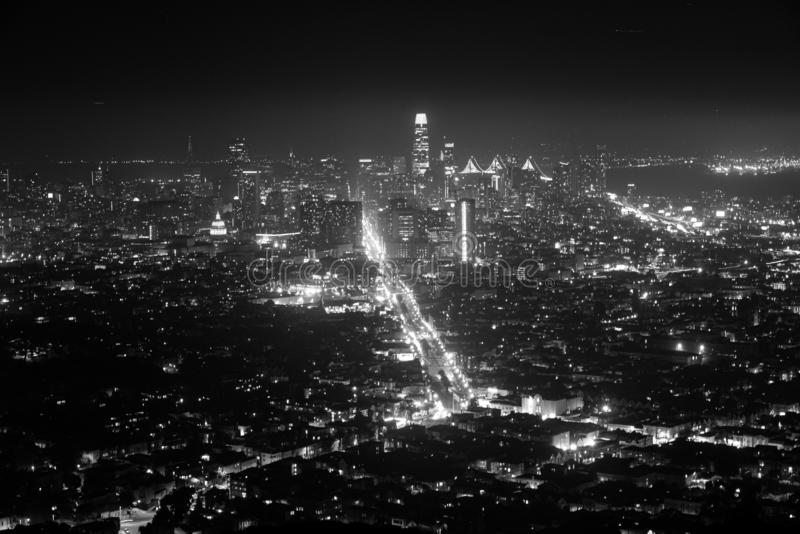 Grayscale cityscape shot of buildings in a city during nighttime. A grayscale cityscape shot of buildings in a city during nighttime royalty free stock photography