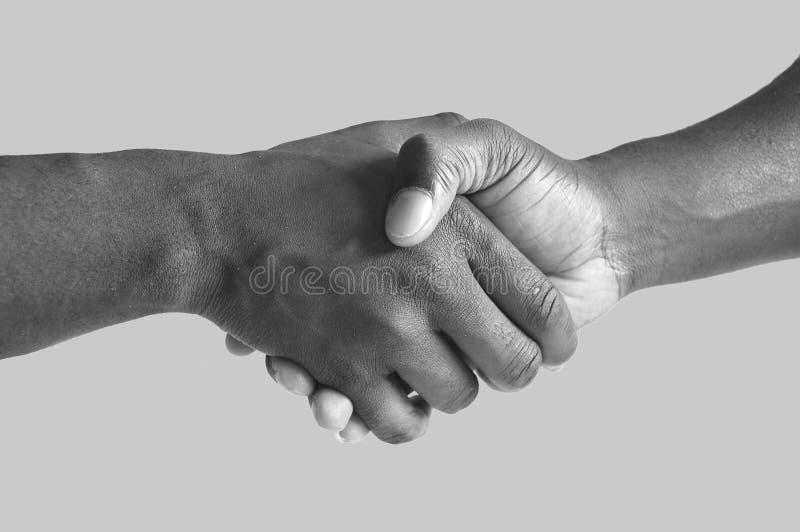 Grayscale negro del apretón de manos fotografía de archivo