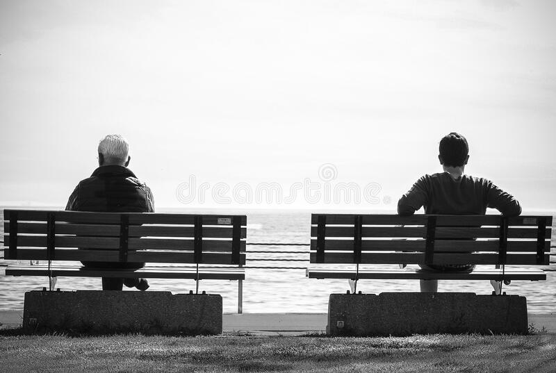 Grayscale Photo 2 Person Sitting In A Separate Benches On The Seaside Free Public Domain Cc0 Image