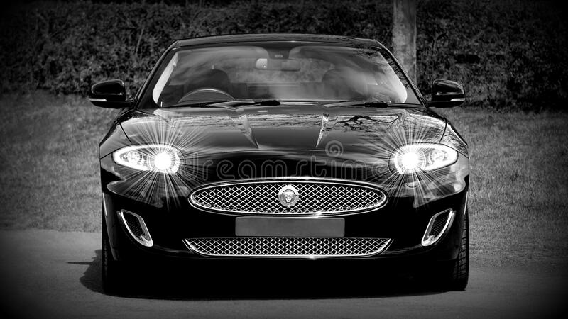 Grayscale Photo of a Black Sports Car Convertible royalty free stock photography
