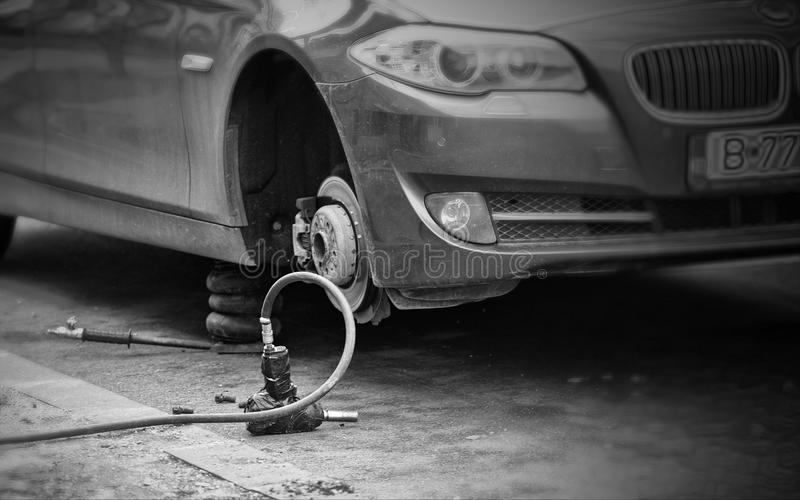 Grayscale Photo of Car Without Wheel stock images