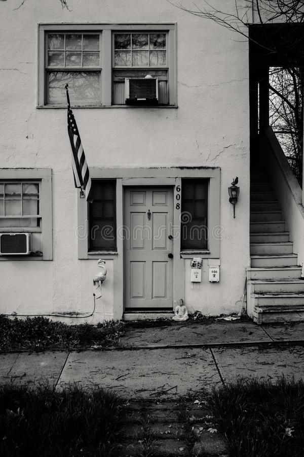 Grayscale Photo of Concrete House With Usa Flag stock images