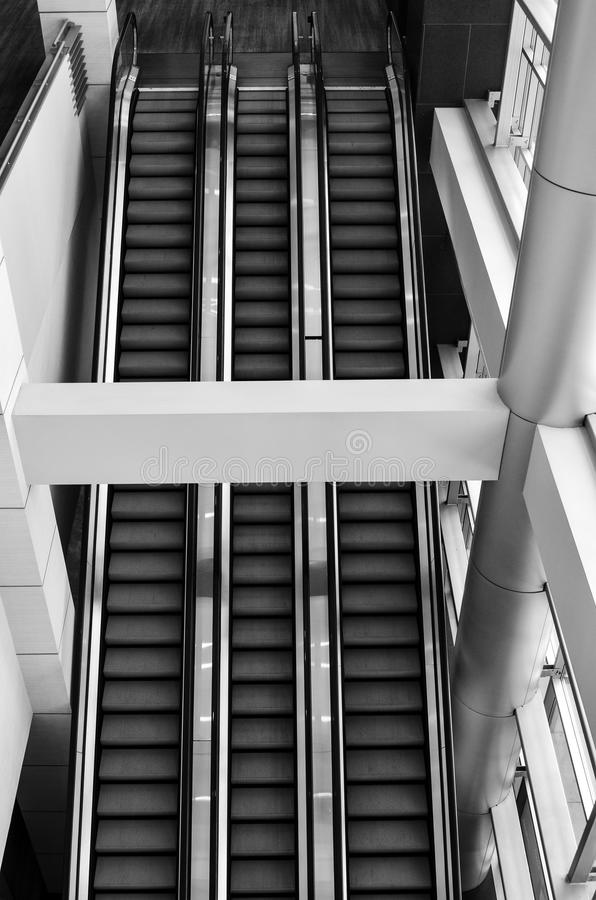 Grayscale Photo of Escalator stock images
