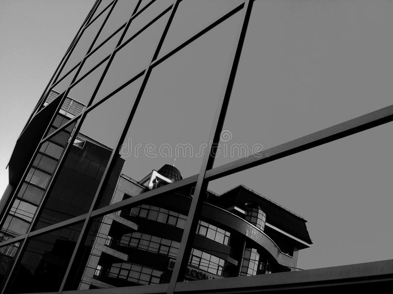 Grayscale Photo Of Glass Curtain Building royalty free stock images