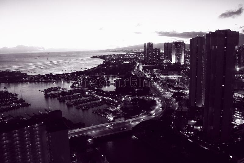 Grayscale Photo Of High Rise Building Near Body Of Water Free Public Domain Cc0 Image
