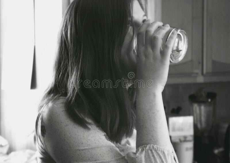 Grayscale Photo of Lady Drinking Water royalty free stock photography