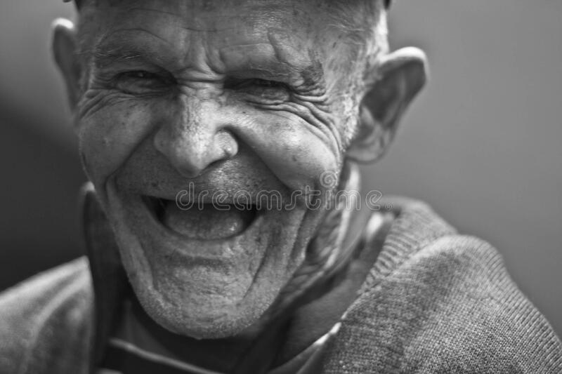 Grayscale Photo of Laughing Old Man stock photos
