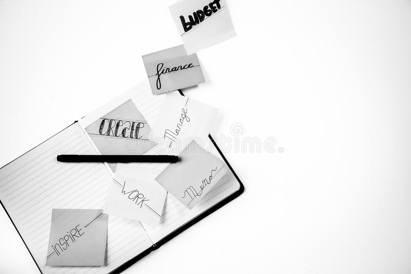 Grayscale Photo of Lined Paper Notebooks and Pen stock image