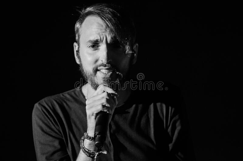 Grayscale Photo of Man Holding Microphone stock photography