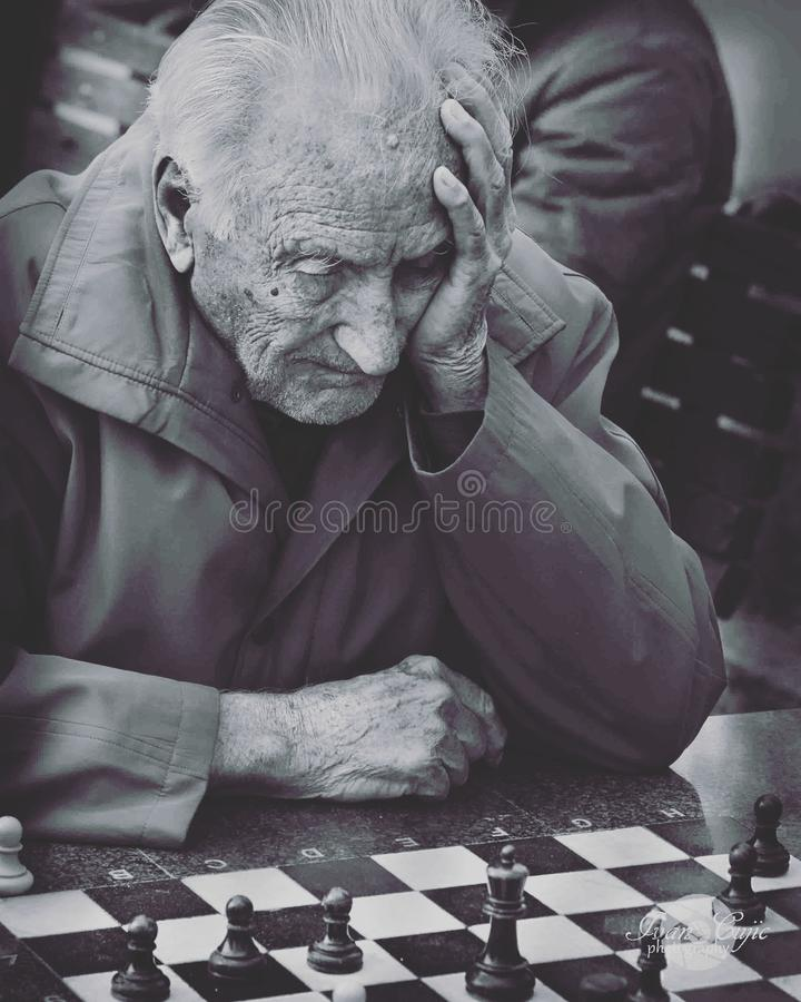 Grayscale Photo of Man Playing Chess stock images