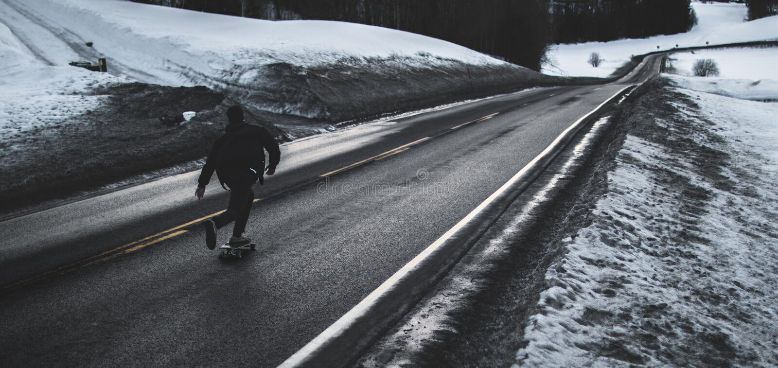 Grayscale Photo of Man Walking on Road royalty free stock photos