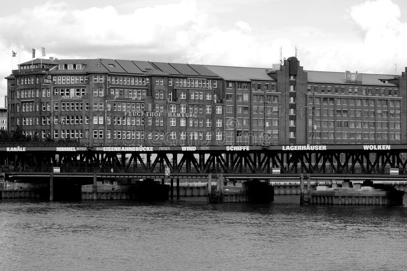 Grayscale Photo of Mid Rise Building Near Body of Water at Daytime stock photos
