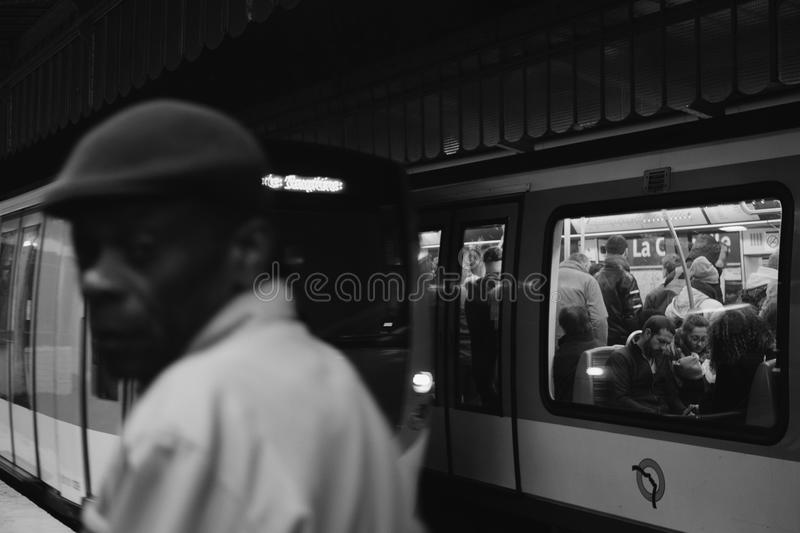 Grayscale Photo of People Inside Train stock images