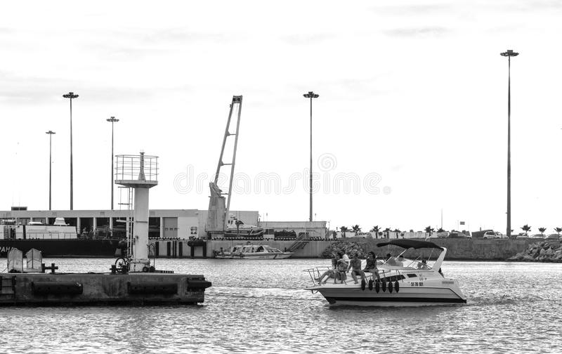 Grayscale Photo of People Riding on Yacht royalty free stock photography