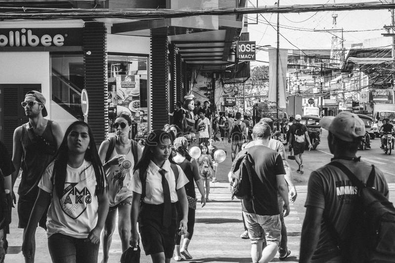 Grayscale Photo of People Walking in the Street stock photography