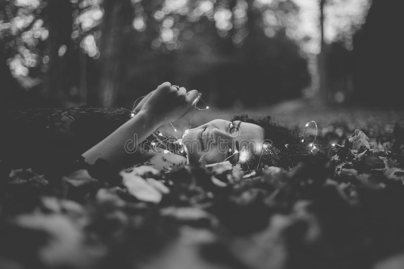 Grayscale Photo of Person Lying on Ground stock image