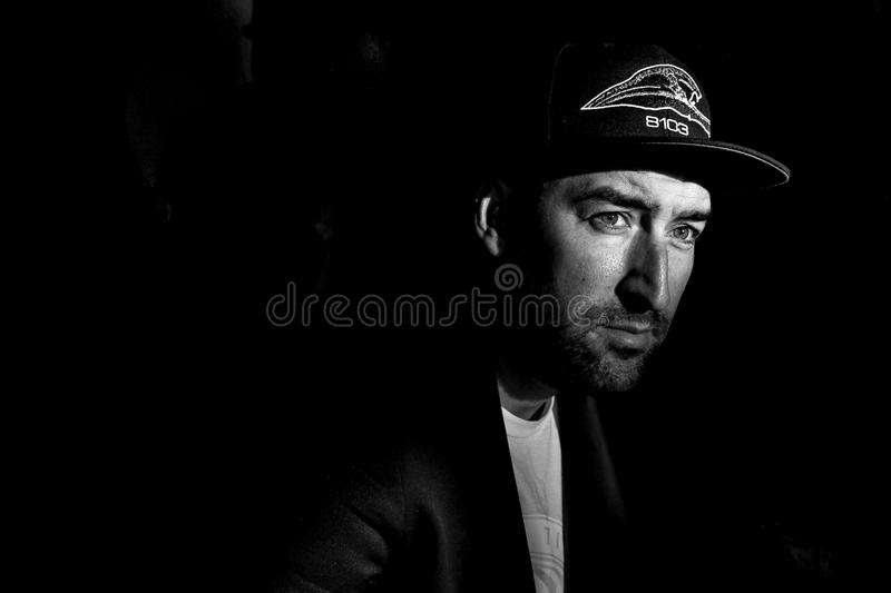 Grayscale Photo Portrait of Man in Black Cap royalty free stock images