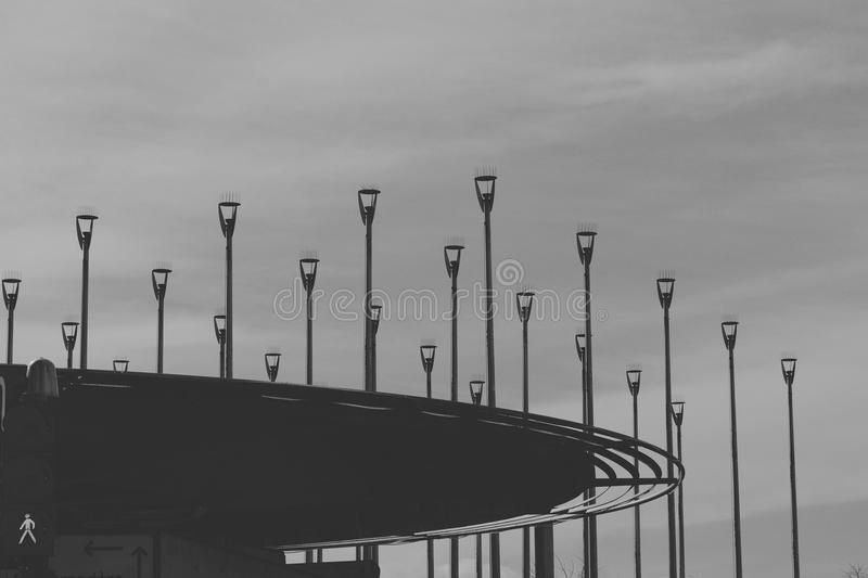 Grayscale Photo of Road Light Post Lot royalty free stock photos