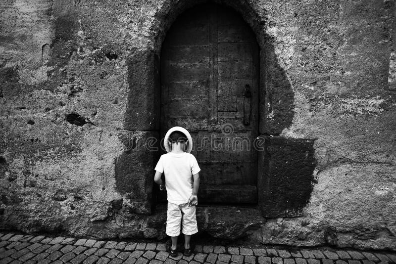 Grayscale Photo Of Toddler Standing And Wearing Hat On The Ground Free Public Domain Cc0 Image