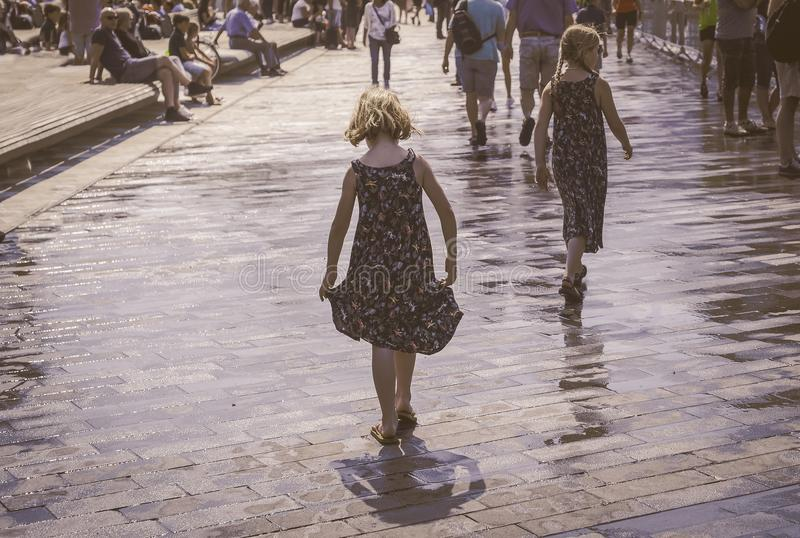 Grayscale Photo of Two Woman Walks on Bricks Pavement Front of People at Daytime stock photo