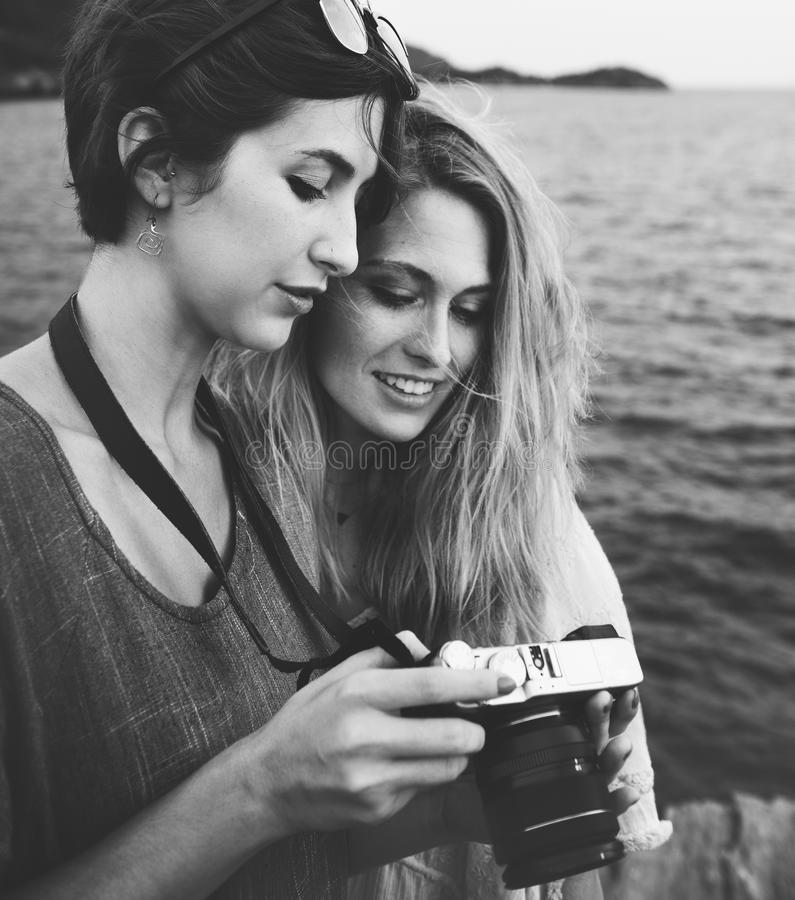 Grayscale Photo Of Two Women Looking At A Camera stock photo