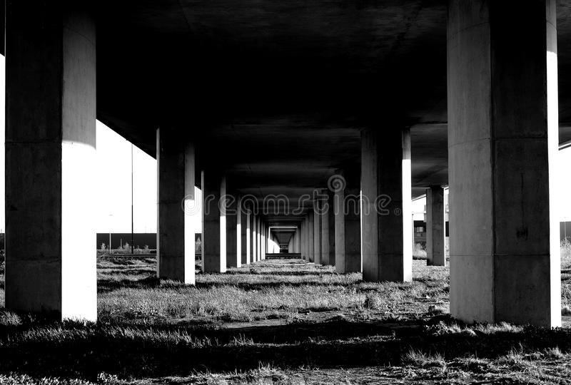 Grayscale Photo Under the Bridge Stand stock photos