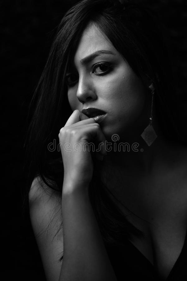 Grayscale Photo of Woman in Black Plunging Neckline Top royalty free stock photos