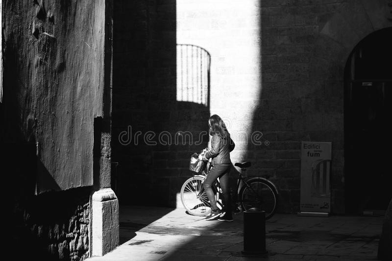 Grayscale Photo of Woman with Her Bicycle stock photography
