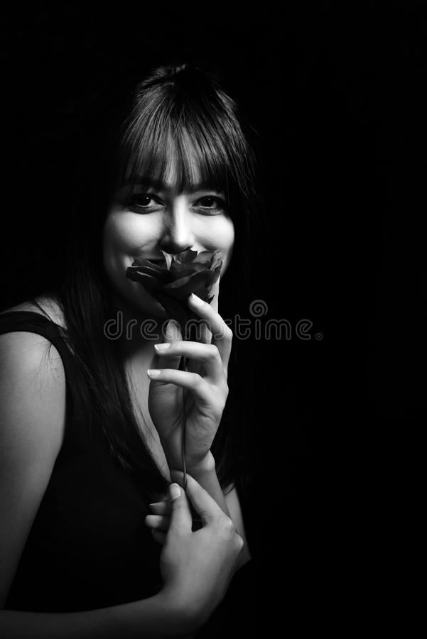 Grayscale Photo of Woman Holding Flower royalty free stock image